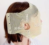 picture of thermoplastics  - Female patient wearing a custom made Thermoplastic Radiotherapy Mask - JPG