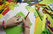 Small Child Makes Paper Crafts For Mother`s Day Or Birthday. Small Child Doing Paper Flowers For Mom poster