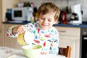 Happy Little Blond Kid Boy Eating Cereals For Breakfast Or Lunch. Healthy Eating For Children. Child poster