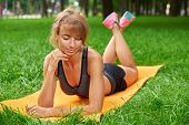 Young Beautiful Girl Engaged In Fitness And Gymnastics In The Park. Morning Gymnastics. Exercise For poster