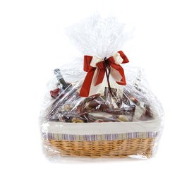 stock photo of gift basket  - Isolated Food hamper with many sweets as a present - JPG
