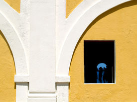 image of san juan puerto rico  - Wall of San Juan fort with tourist in window - JPG