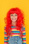 Ready For Super Party. Party Girl Yellow Background. Happy Child Wear Red Colored Party Wig. Perfect poster