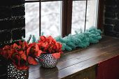 Christmas Window Sill Decor. New Years Decor Is Lying On The Window Sill Against The Window. poster