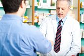 pic of erectile dysfunction  - Customer giving a prescription to his pharmacist - JPG