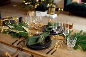 Table Served For Christmas Dinner In Living Room, Close-up View, Table Setting, Christmas Decoration poster