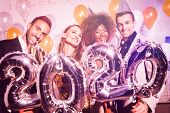 Party people women and men celebrating new years eve 2020 with sparklers and Champagne poster