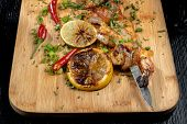 Shrimp Shrimp, Decorated With Herbs, Next To The Grilled Lemons. poster
