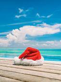 Christmas winter holidays santa hat near swimming pool of Caribbean resort travel vacation destinati poster