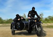 stock photo of sidecar  - Two armed men riding a motorcycle with a sidecar - JPG