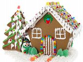stock photo of ginger bread  - Gingerbread house and christmas tree on the white background - JPG