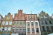 Facades Of Historic Tenement Houses On The Old Market Square In Poznan poster
