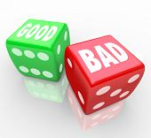 A red dice with the word Bad and a green die with the word Good for you to roll and determine the outcome of a game or situation, will the answer be positive or negative