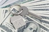Home Keys And A Small House On Currencies Dollar Background. The Concept Of Renting Or Selling A Hou poster