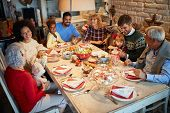 Happy Family and friends at  Christmas dinner.Christmas eve with traditional food. poster