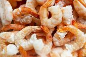 Raw Frozen And Peeled Shrimp Background. Pile Of Frozen Shrimps  .close-up Of Frozen Shrimps. A Lot  poster