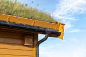 Focus On Rain Gutter On Roof. Close Up View Of Modern Wooden House Covered And Insulated With Extens poster