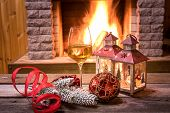Christmas Eve. Glass Of Wine, Christmas Lanterns And Christmas Decorations Near Cozy Fireplace, In C poster
