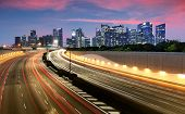 Movement Of Car Light With Singapore Cityscape Skyline During Sunset poster