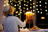 Kids Celebrating Hanukkah. Jewish Festival Of Lights. Children Lighting Candles On Traditional Menor poster