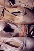 Cropped Shot Of An Old Pointe Shoes. Cropped Shot Of Ballet Shoes. Abstract Ballet Background. Point poster