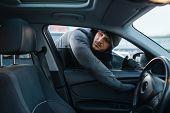 Car robber opening door, risk job, stealing poster