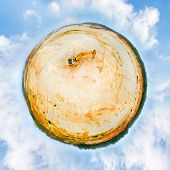 Tiny planet with ecologic disaster. 360 degrees aerial panorama of golden ore quarry with excavator. poster