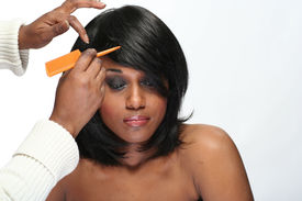 pic of african american woman  - african american woman having her hair styled - JPG