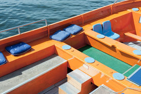 pic of sloop  - colorful seats of a polyester cruising sloop - JPG