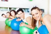 stock photo of pilates  - Group of people in a class of Pilates at the gym - JPG
