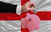 Dollar Into Piggy Rich Bank And  National Flag Of England