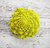 stock photo of romanesco  - Raw Romanesco broccoli on wooden background - JPG