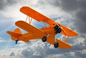 image of propeller plane  - Retro style picture of the biplane - JPG