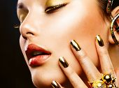 Fashion Girl Portrait. Gold Makeup. Golden nails and Eyeshadows. Golden Make-up and Nailpolish