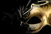 stock photo of masquerade mask  - ornate carnival mask over black silk background - JPG