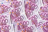 many five hundred euro banknotes lie side by side. symbolic photo for wealth and investment