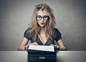 foto of typewriter  - beautiful woman writes with a typewriter - JPG