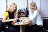 Two Happy Blond Girls Making Manicure