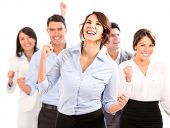 pic of coworkers  - Successful business team celebrating with arms up  - JPG