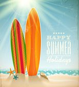 Vector holidays vintage design - surfboards on a beach against a sunny seascape