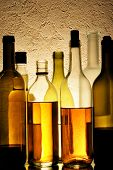 stock photo of alcoholic drinks  - Lots bottles of alcohol drinks over textured background - JPG