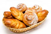 Group Of Delicious Cinnamon Rolls In Basket Isolated