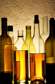 pic of alcoholic drinks  - Lots bottles of alcohol drinks over textured background - JPG