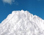 pic of snow shovel  - White snow pile against blue sky in winter - JPG