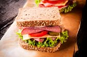 stock photo of raw chicken sausage  - Toast sandwich with vegetables cheese and sausage