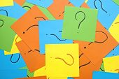 pile of colorful sticky notes with question marks symbolizing ideas, inspiration and creativity  Ideas backgrounds.
