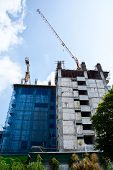A big building under construction on nice sky
