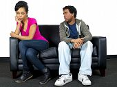 picture of cheater  - young black male and female couple isolated on a couch - JPG