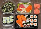 foto of takeaway  - Takeaway Japanese food assortment on wooden table - JPG
