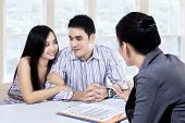 picture of filipino  - Young couple meeting consultant for financial contract at home - JPG